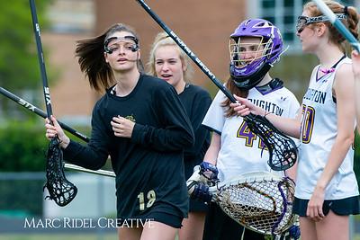 Broughton Lady Caps varsity lacrosse vs Leesville. April 9, 2019. D4S_4168
