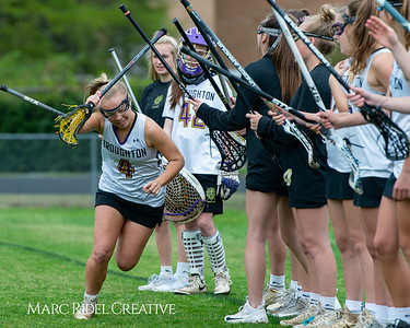 Broughton Lady Caps varsity lacrosse vs Leesville. April 9, 2019. D4S_4110