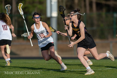 Broughton Lady Caps lacrosse at Middle Creek. February 26, 2019. D4S_1649