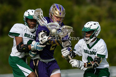 Broughton varsity lacrosse vs Southeast Raleigh. April 4, 2019. D4S_1734