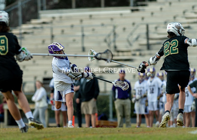 Broughton boys varsity lacrosse vs Enloe. March 10, 2020. D4S_7909