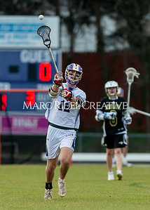 Broughton boys varsity lacrosse vs Enloe. March 10, 2020. D4S_7887