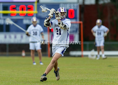 Broughton boys varsity lacrosse vs Enloe. March 10, 2020. D4S_7871