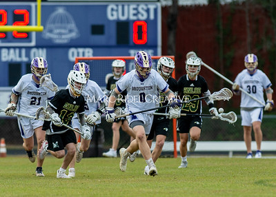 Broughton boys varsity lacrosse vs Enloe. March 10, 2020. D4S_7860