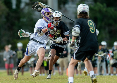 Broughton boys varsity lacrosse vs Enloe. March 10, 2020. D4S_7921