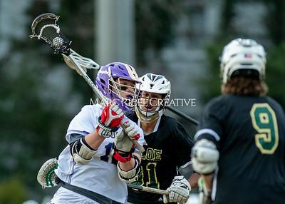 Broughton boys varsity lacrosse vs Enloe. March 10, 2020. D4S_7922