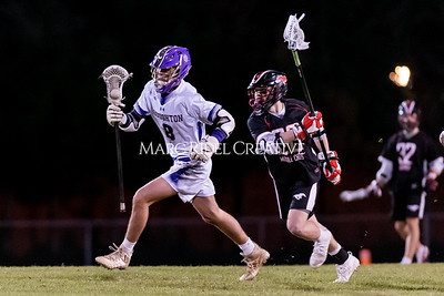 Broughton boys varsity lacrosse vs Middle Creek. February 28, 2020. D4S_0822