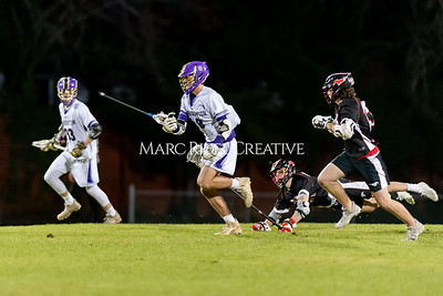 Broughton boys varsity lacrosse vs Middle Creek. February 28, 2020. D4S_0824