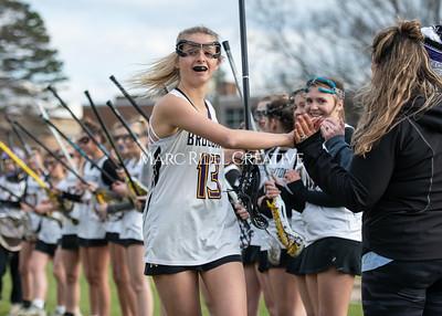 Broughton girls varsity lacrosse vs Middle Creek. February 28, 2020. MRC_5434