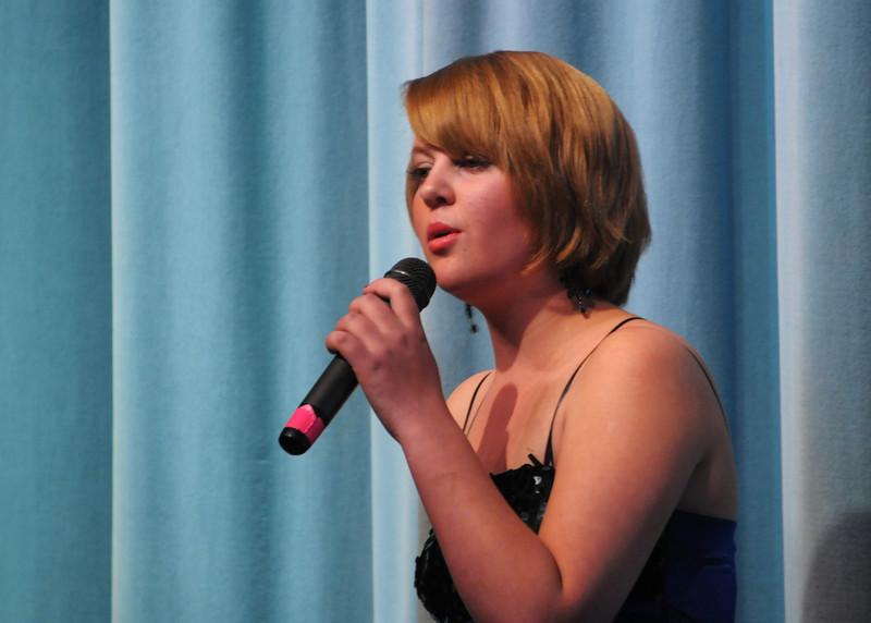 NEA_1086-7x5-Singer