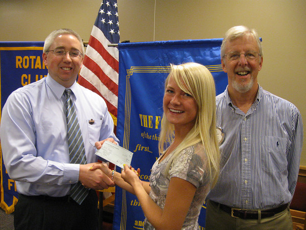 Tinley Park High School graduate Noelle Thompson accepts a scholarship check from Tinley Park-Frankfort Rotary Club Treasurer Sean Brady and Rotary Club President Paul Lyons.