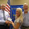 Tinley Park High School graduate Noelle Thompson accepts a scholarship check from Tinley Park-Frankfort Rotary Club Treasurer Sean Brady and Rotary Club President Paul Lyons.