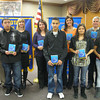 The Tinley Park-Frankfort Rotary Club recently donated dictionaries to 34 Lincoln-Way High School District 210 students who are learning English as a second language. Pictured here from left to right are Rotarian/Lincoln-Way High School District 210 Director of Instruction Tim Reilly, student Agustin Ocampo, teacher Elise Baden, teacher Alexandra Marquez, student Mohammad Salameh, teacher Jacquelyn Randall, student Heena Soni, Rotarian Steve Purucker and student Stephanie Casimiro.