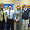 New  members Laci Smith, a banking center manager for MB Financial Bank, and Jan Paul Ferrer, a financial advisor with Morgan Stanley Smith Barney pose with present elect and  Assistant District Governor for Rotary District 6450 Karen Wegrzyn,and current president Paul Lyons.