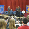 Paul Lyons, president of the Tinley Park-Frankfort Rotary, and Brenda Jensen, principal at Lincoln-Way East High School, congratulate one of the Top 10 honorees March 14.