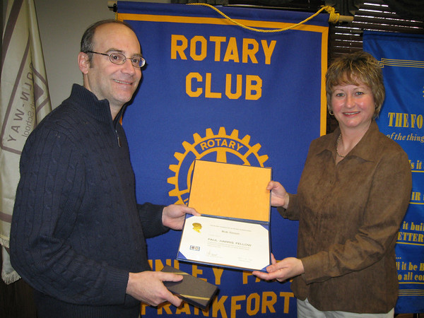 "Rotary recognizes local businessman for contributions to community...<br /> <br />    Impressed with local businessman Bob Simon's commitment to the community, members of the Tinley Park-Frankfort Rotary club presented him with the group's highest honor –a  Paul Harris fellowship.<br />  <br />    ""You have set an example for many by your contributions to your community,"" Rotary President Karen Wegrzyn told Simon during a presentation ceremony Thursday, Feb. 26, at Lincoln-Way East High School.<br /> <br />    ""Your personal involvement makes your community a better place in which to live,"" she added.<br /> <br />    Simon, who owns and manages the Culver's restaurant at 20592 S. LaGrange Road in Frankfort, has helped a number of families in crisis, delivering food to those impacted by an early morning home explosion in September that killed a Frankfort couple and displaced several other families.<br /> <br />    He also generously donated a percentage of sales to the Lane Bryant Tinley Park Memorial Fund last year, helping families whose loved ones were slain at the Tinley Park clothing store in February 2008.<br /> <br />    The Paul Harris fellowship, named after the founder of the Rotary Club, is presented to non-Rotarians who exemplify Harris' spirit of humanitarianism and service to others.<br />  <br />    Tinley Park-Frankfort Rotarians saw those qualities in Simon and made a contribution in his name to the Rotary Foundation, which works to advance world understanding, goodwill and peace through the improvement of health, the support of education and the alleviation of poverty.<br /> <br />    The contribution could provide educational opportunities, food for the poor, potable water in a village in Africa or India, health care, shelter, schools and books for thousands of children, said Wegrzyn. It could also buy cows to supply milk to an entire village or supply sewing machines to widows so they may become self sufficient."