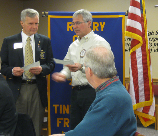 """District governor visits Tinley Park-Frankfort Rotary:<br /> <br />    The Tinley Park-Frankfort Rotary Club is working hard to make the world a better place to live by eradicating polio, alleviating poverty and supporting education around the world.<br /> <br />    On Dec. 10, Rotary President Steve Purucker (right) presented, on behalf of  the service club organization, two checks totaling $2,400 to Jim Czerwionka, the District Governor of Rotary District 6450.<br /> <br />    One check will be used for the Rotary Foundation's mission to advance world understanding, goodwill and peace through improved health and education while the other will be used to support immunization campaigns in developing countries where polio continues to infect and paralyze children.<br />    """"I'm proud to be a part of this organization,"""" Steve Purucker, president of the Tinley Park-Frankfort Rotary said before presenting the checks to Czerwionka.<br /> <br />    The club, which has grown to include 18 professional and community leaders from Frankfort and Tinley Park, is part of a worldwide organization that participates in a broad range of humanitarian, intercultural and educational activities designed to improve the human condition locally, nationally and globally.<br /> <br />    Locally, it awards scholarships to high school seniors each year and donates dictionaries to third-grade students in the Harvey School District. It recently raised over $1,000 for the Crisis Center of South Suburbia, which provides emergency shelter and other essential services to individuals and families victimized by domestic violence.<br /> <br />    Rotary Club members sell poinsettias, Carson's Community Day coupon books and program booklet ads to raise cash for its many endeavors. <br /> <br />    """"Rotary lets insignificant people do some very extraordinary things,"""" said Czerwionka.<br /> <br />    """"It allows me to have an impact on the world,"""" he added.  """"That makes me feel good."""""""