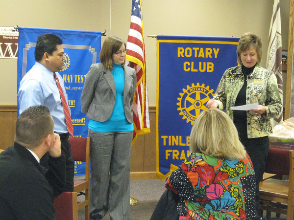 """The Tinley Park-Frankfort Rotary Club inducted two new members at its March 31 meeting. They are Laci Smith, a banking center manager for MB Financial Bank, and Jan Paul Ferrer, a financial advisor with Morgan Stanley Smith Barney.<br />  <br />    """"It is the duty of our Rotary club to add new members from time to time so that we may not only increase our usefulness and influence as a club but also to extend the spirit of Rotary throughout the community,"""" said Karen Wegrzyn, Assistant District Governor for Rotary District 6450. """"Today, I welcome to our ranks and admit to membership Laci and Jan Paul.""""<br /> <br />    Both individuals were elected to membership because they are admirable representatives and possess qualities that will permit them to exemplify the true spirit of Rotary in their public, business, social and private lives, she added."""