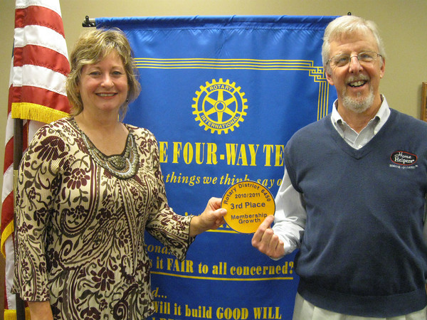 "Tinley Park-Frankfort Rotary Club President Karen Wegrzyn and immediate Past President Paul Lyons show the award the club recently received for membership growth. <br /> <br /> ""We are extremely honored to have won third place for membership growth,"" said Rotarian and immediate past president Paul Lyons. ""It is a testament to the dedication of our club members that we have achieved this great award."""