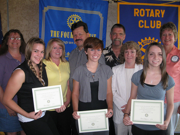 Karen Wegrzyn, president of the Tinley Park-Frankfort Rotary Club, joins the scholarship winners and their parents for a photo. Pictured from left to right are: Ellen Aardsma, Ashley Aardsma, Debbie Brown, Mike Brown, Megan Brown, Paul Harjung, Karen Harjung, Kelly Harjung and Karen Wegrzyn. The Tinley Park-Frankfort Rotary Club has awarded nearly $200,000 in scholarships to students since it was chartered in 1975.