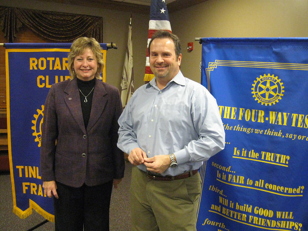 Karen Wegrzyn, president of the Tinley Park-Frankfort Rotary Club, welcomes a new member -- Dennis Platipodis -- to the club. Platipodis, who is a first vice president with Citizens Financial Bank, said he was drawn to the club because of its community service work.