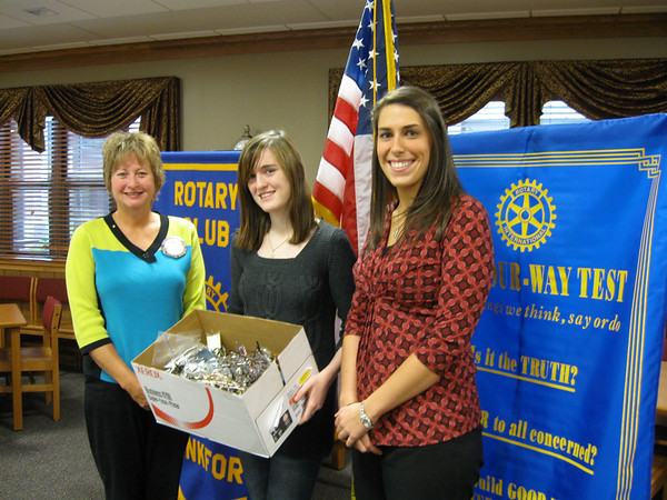 Tinley-Park Frankfort Rotary President Karen Wegrzyn (left) accepts 144 pairs of prescription eyeglasses from Lincoln-Way North student Deirdre Harrington and Lincoln-Way North teacher Amy Madonia.  The school's social science classes (led by department chair Michelle Maldonado) held a collection drive for Make a Difference Day, and the school's Interact Club, sponsored by Madonia,  presented them to the Rotary on Nov. 6. The Rotary plans to send the glasses to Volunteers in Optometric Service to Humanity (VOSH), an organization that provides eye care to underdeveloped countries.