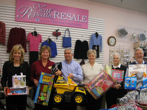 Members of the Tinley Park-Frankfort Rotary Club recently visited Neat Repeats Resale shop to deliver toys, food and gift cards that will benefit the Crisis Center for South Suburbia. The Rotary Club sold poinsettias during the holidays and raised $1,200 for the Crisis Center. Pictured here (from left to right) are Rotarians Janelle Witry, Karen Wegrzyn, Steve Purucker, John Lachat and Paul Lyons with Neat Repeats store manager Cindy Polk (center).