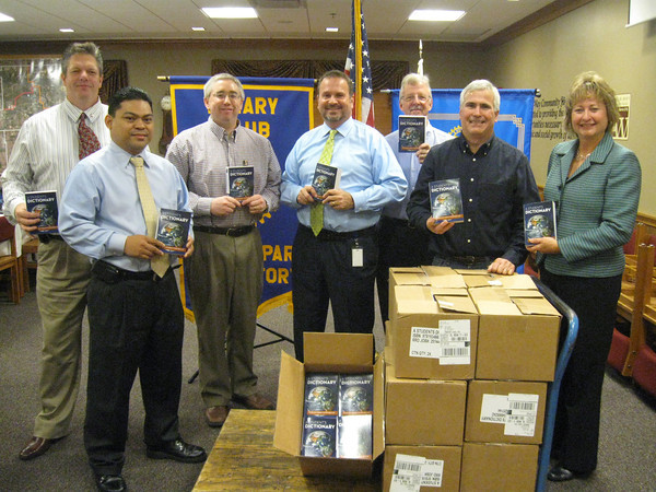 "Tinley Park-Frankfort Rotary donates 336 dictionaries<br />  <br />   Thanks to a donation by the Tinley Park-Frankfort Rotary, third-graders in Harvey School District 152 will have a resource tool of their own to turn to when looking up word spellings, facts about the planets or maps of the seven continents.<br />  <br />    The Tinley Park-Frankfort Rotary Club recently donated dictionaries to every third-grader in the district as well as students at Ralph J. Bunche School in Hazel Crest. The service club, which has been handing out dictionaries to students for the past six years, has donated more than 1,500 books to date.<br /> <br />    The dictionaries are so multi-faceted, with sections about weights and measurements, biographies of the U.S. presidents and copies of the Declaration of Independence and U.S. Constitution, that Rotarians decided to donate a collection to English Language Learners (ELL) and English as Second Language (ESL) students at Andrew High School as well. <br /> <br />    A similar donation has been made to ELL students at Lincoln-Way North, Lincoln-Way East and Tinley Park high schools in the past.<br />  <br />    ""It is our pleasure to present these dictionaries to students so that they can discover new words and always have a resource tool at hand when completing homework assignments,"" said Tinley Park-Frankfort Rotarian Steve Purucker who organizes the dictionary project each year.<br /> <br />    ""Literacy has always been an important issue for Rotary International,"" added Rotarian Karen Wegrzyn.  ""At the local level, this project allows us to make an impact on those who live right here in our own back yard.""<br />  <br />    The club, which is comprised of business and community leaders from Frankfort and Tinley Park, is part of a worldwide organization that participates in a broad range of humanitarian, intercultural and educational activities designed to improve the human condition locally, nationally and globally. <br />  <br />    It routinely raises money for victims of domestic violence, collects paper goods for the Frankfort and Tinley Park food pantries, and provides scholarships to graduating high school seniors from Andrew, Tinley Park, Lincoln-Way East and Lincoln-Way North high schools.<br />  <br />   This is the sixth year the club has donated dictionaries to the Harvey School District and the third year it has donated dictionaries to students who are learning English as a second language. Students at Ralph J. Bunche School in Hazel Crest have benefitted from the dictionary project the last two years.<br /> <br /> In this photo, Tinley Park-Frankfort Rotary Club members get ready to deliver dictionaries to students in Harvey School District 152 and Ralph J. Bunche School in Hazel Crest."