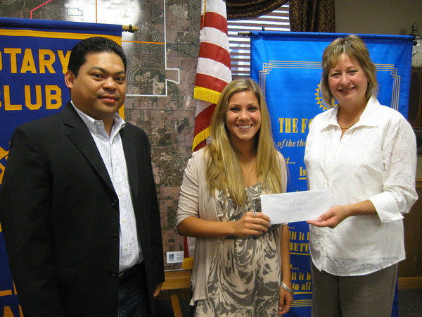Lincoln-Way North High School graduate Dena Waldier accepts a $1,000 scholarship from Tinley Park-Frankfort Rotary Club member JP Ferrer and President Karen Wegrzyn.
