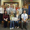 Members of the Tinley Park-Frankfort Rotary club recently accepted 41 pairs of eyeglasses from students at Lincoln-Way North High School. The eyeglasses, collected for a Make a Difference Day project at the school, will be sent to Volunteers in Optometric Service to Humanity (VOSH), an organization that provides eye care to underdeveloped countries. Pictured from left to right are (front row) Lincoln-Way North High School Student Activities Coordinator Jaime Calby, Lincoln-Way North sophomore Courtney Collins, Lincoln-Way North sophomore Cailey Fitzgerald and Lincoln-Way North social science teacher Kevin McCleish; (back row) Rotarians Dave Brost, Janelle Witry, Jay Walsh, Karen Wegrzyn, Sean Brady, Steve Purucker, John Tadla, John Lachat, Tony Brandolino and Matt Lyke.