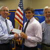 Lincoln-Way East High School graduate Joshua Dietrich accepts a scholarship check from Tinley Park-Frankfort Rotary Club Treasurer Sean Brady and Club President Paul Lyons.