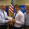 Lincoln-Way East High School graduate Joshua Dietrich accepts a scholarship check from Tinley Park-Frankfort Rotary Club Treasurer Sean Brady and Club President Paul Lyons.