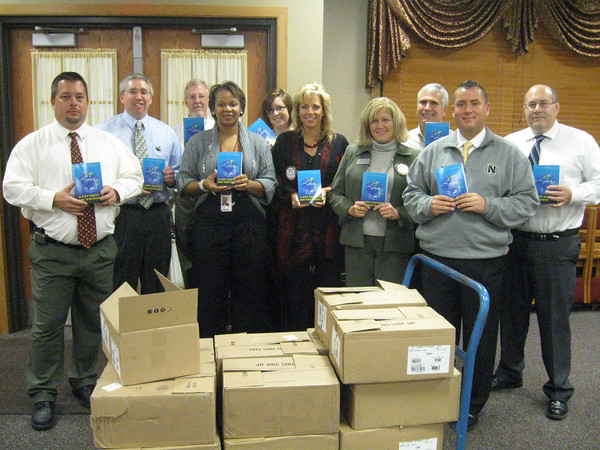 """Tinley Park-Frankfort Rotary Club members prepare to send dictionaries to every third-grade student in Harvey School District 152. Pictured from left to right are Rotarians Tony Brandolino, Sean Brady, Paul Lyons, Wendy Bumphis, Janelle Witry, Margaret Semmer, Steve Purucker, Matthew Lyke and Tim Reilly.<br /> <br /> Third-graders in Harvey School District 152 now have a resource tool of their own to turn to when looking up word spellings, facts about the planets or maps of the seven continents.<br /> <br />    The Tinley Park-Frankfort Rotary Club recently donated dictionaries to every third-grader in the district. The dictionaries are multi-faceted, including sections about weights and measurements, biographies of the U.S. presidents, facts about each state (including the state capitals, sizes, mottos, trees, birds, flowers and songs) and copies of the Declaration of Independence and U.S. Constitution.<br /> <br />    """"For many students, this is the first book they have ever owned,"""" said Paul Lyons, president of the Tinley Park-Frankfort Rotary Club.<br /> <br />    This is the fourth year the club has donated dictionaries to students in the Harvey school district. The club selected Harvey after reading about their financial challenges in a local newspaper."""