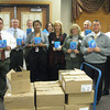 "Tinley Park-Frankfort Rotary Club members prepare to send dictionaries to every third-grade student in Harvey School District 152. Pictured from left to right are Rotarians Tony Brandolino, Sean Brady, Paul Lyons, Wendy Bumphis, Janelle Witry, Margaret Semmer, Steve Purucker, Matthew Lyke and Tim Reilly.<br /> <br /> Third-graders in Harvey School District 152 now have a resource tool of their own to turn to when looking up word spellings, facts about the planets or maps of the seven continents.<br /> <br />    The Tinley Park-Frankfort Rotary Club recently donated dictionaries to every third-grader in the district. The dictionaries are multi-faceted, including sections about weights and measurements, biographies of the U.S. presidents, facts about each state (including the state capitals, sizes, mottos, trees, birds, flowers and songs) and copies of the Declaration of Independence and U.S. Constitution.<br /> <br />    ""For many students, this is the first book they have ever owned,"" said Paul Lyons, president of the Tinley Park-Frankfort Rotary Club.<br /> <br />    This is the fourth year the club has donated dictionaries to students in the Harvey school district. The club selected Harvey after reading about their financial challenges in a local newspaper."