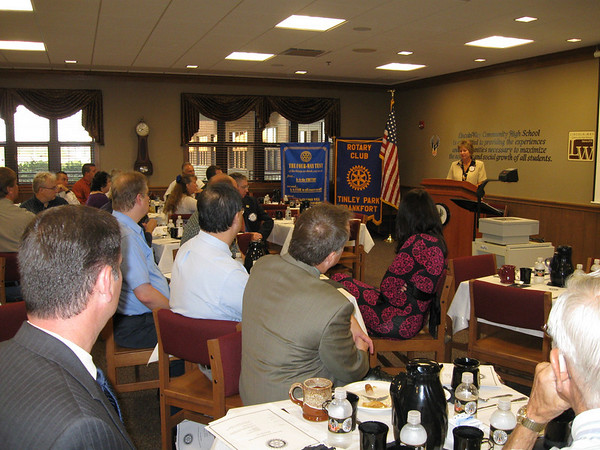Tinley Park-Frankfort Rotary Club President Karen Wegrzyn explains to visitors what the service organization does.
