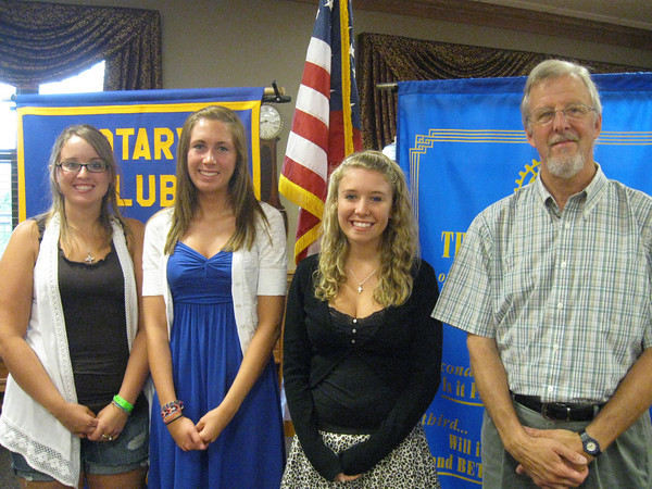 Tinley Park-Frankfort Rotary Club President Paul Lyons (far right) congratulates three of the four high school students who were selected to receive $1,000 scholarships from the club. Recipients included (from left to right) Tinley Park High School graduate Megan McClafferty, Lincoln-Way North graduate Alexa Pennington and Lincoln-Way East graduate Vanessa Stokes. Not pictured is the fourth scholarship winner, Molly Garand from Andrew High School.
