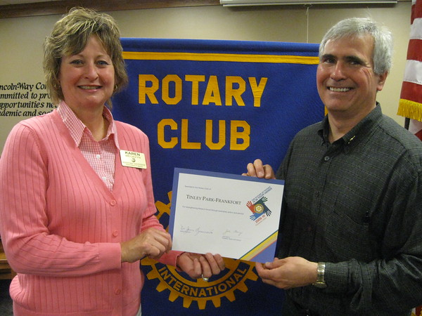 """Karen Wegrzyn, Assistant District Governor for Rotary District 6450, presents Steve Purucker, president of the Tinley Park-Frankfort Rotary Club, with a  Presidential Citation on May 13 for his efforts to strengthen Rotary's future through exemplary action and service. """"It's been a great year,"""" Wegryzn told the Rotary president.  """"Thanks for all your hard work."""""""