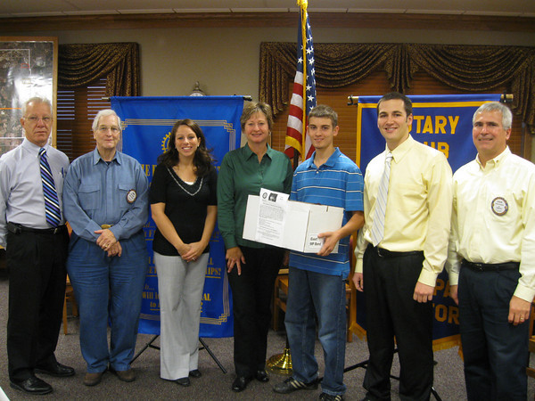 Members of the Tinley Park-Frankfort Rotary Club accept more than 100 pairs of prescription eyeglasses from students at Lincoln-Way North High School. <br /> <br /> The school's social science classes held a collection drive for Make a Difference Day and presented them to the Rotary on Oct. 29. The glasses will be sent to Volunteers in Optometric Service to Humanity (VOSH), an organization that provides eye care to under developed countries. <br /> <br /> Pictured here are (from left to right): Rotary member and Lincoln-Way East High School Athletic Director David Brost, Rotary member John Lachat, Lincoln-Way North High School Student Activities Coordinator Jaime Robison, Assistant District Governor for Rotary District 6450 Karen Wegrzyn, Lincoln-Way North junior Mark Catania, Lincoln-Way North teacher Matt Lawerence and Rotary President Steve Purucker.