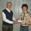 Senior Patrol Leader Kurt Lezon of Frankfort Boy Scout Troop 270 presents Rotary Club President Paul Lyons with a check to benefit ShelterBox International