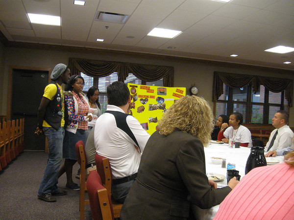 """Tinley Park High School Interact Club members Charles Mitchell, Phlinda Thompson and Ryan Brown talk about some of the community service projects they have been involved in this school year, including a Halloween Safe House, Senior Citizen Prom and Crop Walk. """"(Interact) is fun,"""" Thompson told the Rotarians. """"You get to help people."""" Interact provides youth, ages 14-18, an opportunity to work together in a world fellowship dedicated to service and international understanding."""