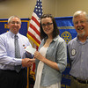 Lincoln-Way North High School graduate Deirdre Harrington accepts a scholarship check from Tinley Park-Frankfort Rotary Club Treasurer Sean Brady and Club President Paul Lyons.