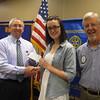 Lincoln-Way North High School graduate Deirdre Harrington accepts a scholarship check from Tinley Park-Frankfort Rotary Club Treasurer Sean Brady and Club President Paul Lyons.