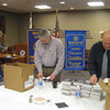Tinley Park-Frankfort Rotarians Karen Wegrzyn, Sean Brady and Tim Reilly sort dictionaries that will be handed out to students in Harvey School District 152.