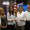 Lincoln-Way East High School graduate Julianne Sipos accepts a $1,000 scholarship from Tinley Park-Frankfort Rotary Club member Margaret Semmer, President Karen Wegrzyn and member Paul Lyons.