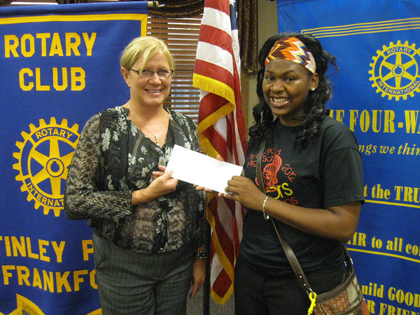 Tinley Park High School graduate Lisa Hurdle accepts a $1,000 scholarship from Tinley Park-Frankfort Rotary Club  President Margaret Semmer.