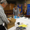 Tinley Park-Frankfort Rotary donates 360 dictionaries <br /> <br /> Tinley Park-Frankfort Rotary club member Steve Purucker and club President Karen Wegrzyn box up dictionaries for donation to the Harvey School District and Tinley Park High School.<br /> <br /> Read more about the project in the caption above.