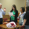 East RYLA report: Tinley Park-Frankfort Rotary Club member Steve Purucker talks to Lincoln-Way East High School students Katie Lucas, Kaylie Herman and Paige Grady about an upcoming community service project.