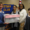 Karen Wegrzyn, president of the Tinley Park-Frankfort Rotary, accepts a box of eyeglasses from Tinley Park High School Interact Club members Priscilla Perez, Phlinda Thompson and Randa Figuigui. The eyeglasses will be sent to Volunteers in Optometric Service to Humanity (VOSH), an organization that provides eye care to underdeveloped countries.