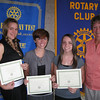 Karen Wegrzyn, president of the Tinley Park-Frankfort Rotary Club, presents scholarships to Tinley Park High School graduate Ashley Aardsma (far left), Lincoln-Way East High School graduate Megan Brown and Lincoln-Way East High School graduate Kelly Harjung during a July 17 Rotary Club meeting in Tinley Park. The service club awards scholarships annually to students who demonstrate outstanding academic achievement and service to the community.