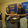 Paul Lyons, president of the Tinley Park-Frankfort Rotary club, presents certificates to the president, vice president and secretary of the Lincoln-Way East High School  Interact club during a recent Rotary meeting. The student club serves as a service partner to Rotary and is involved in a number of community service projects and fund-raising efforts.